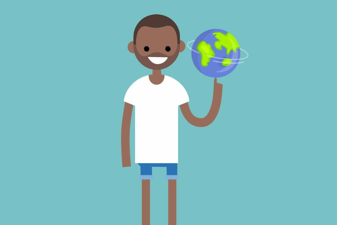 A boy holding a globe